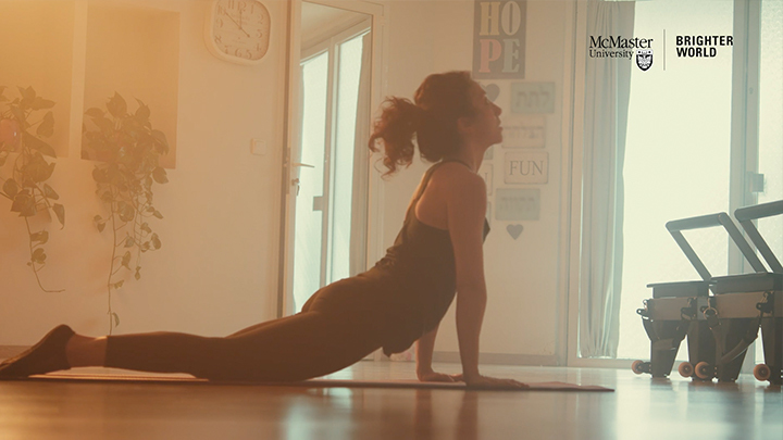 A woman doing yoga in her home